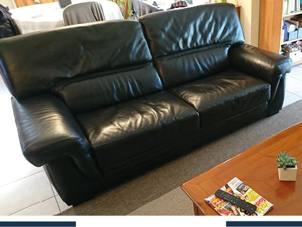 rénovation et teinte : un canapé cuir vert en noir